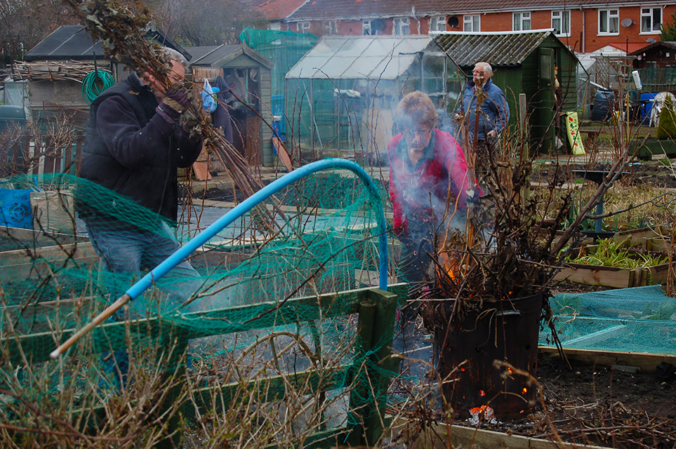 Bernie and Joan burning dry weeds at Wharncliffe Allotments.
