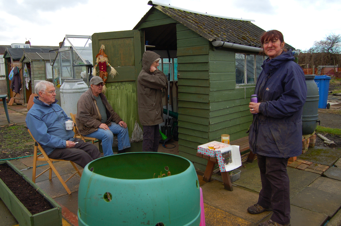 Allotment members gather at Joan's shed for tea and cake